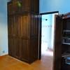 cupboards and door to bathroom in smaller bedroom.