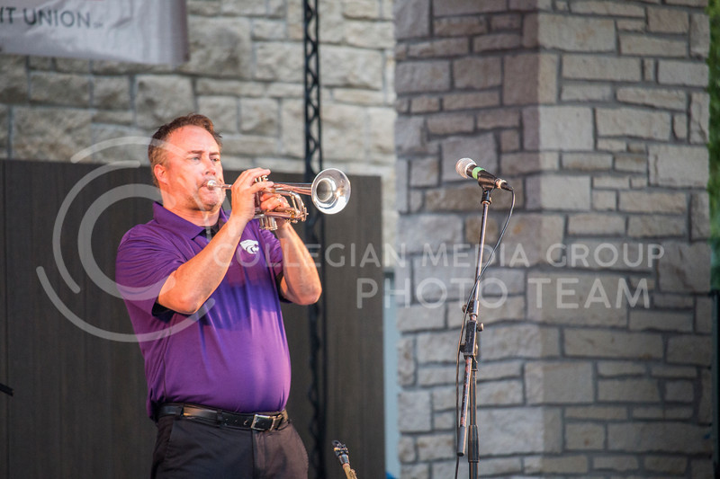 Bret Goter of Groove 42 plays the trumpet during Purple Power Play 2017 in Manhattan, Kan. on September 1, 2017. The Purple Power Play festival celebrates the beginning of the 2017 K-State football season. (Logan Wassall | Collegian Media Group)