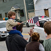 KRISTOPHER RADDER — BRATTLEBORO REFORMER<br /> Nico Simunovic, 2, from Putney, Vt., watches from his father's shoulders as teachers from  Putney Central School pass by with first responders during a vehicle parade on Friday, May 8, 2020.  The teachers wanted to reach out to the local community after the COVID-19 pandemic closed the school for the rest of the academic year.