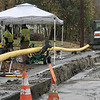 The rain did not hinder Neuco New England Utility Constructors Inc. as they worked to put in a gas line on Pleasant Street in Leominster on Tuesday afternoon. SENTINEL & ENTERPRISE/JOHN LOVE
