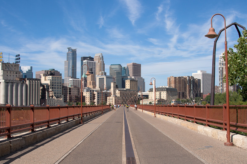 The Stone Arch Bridge with the Minneapolis Skyline on the other side.
