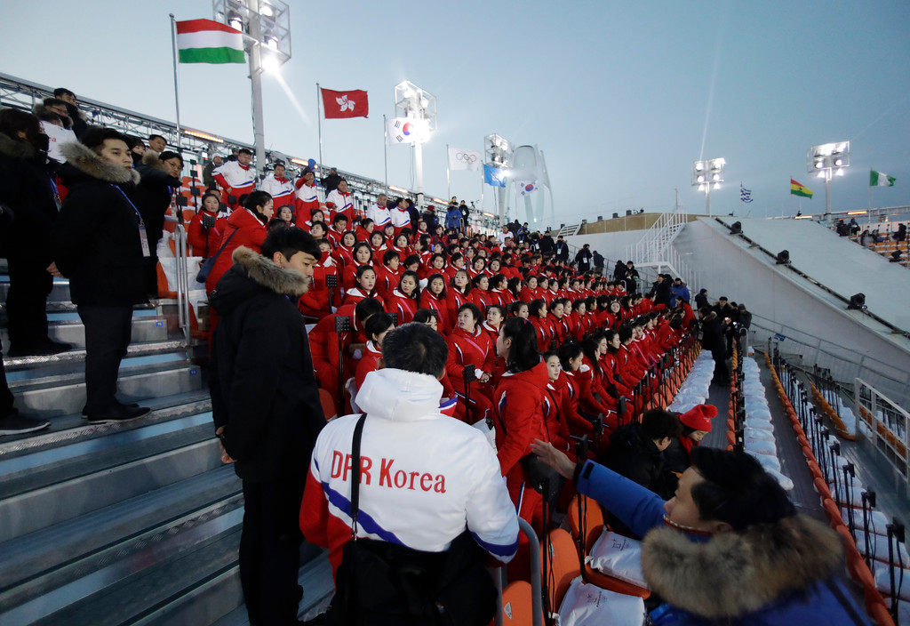 . Members of the North Korean delegation sit before the opening ceremony of the 2018 Winter Olympics in Pyeongchang, South Korea, Friday, Feb. 9, 2018. (AP Photo/Matthias Schrader)