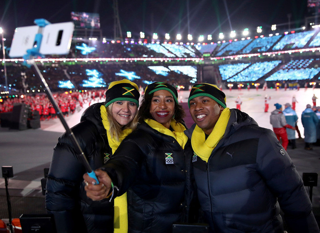 . Athletes from Jamaica take a selfie during the opening ceremony of the 2018 Winter Olympics in Pyeongchang, South Korea, Friday, Feb. 9, 2018. (Clive Mason/Pool Photo via AP)