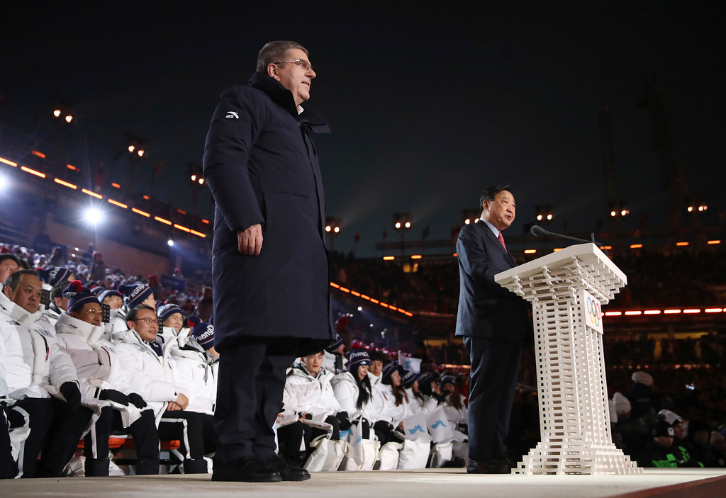 . Thomas Bach, left, president of the International Olympic Committee, and Lee Hee-beom, president & CEO of the PyeongChang Organizing Committee for the 2018 Olympic and Paralympic Winter Games, stand on stage during the opening ceremony of the 2018 Winter Olympics in Pyeongchang, South Korea, Friday, Feb. 9, 2018. (Clive Mason/Pool Photo via AP)