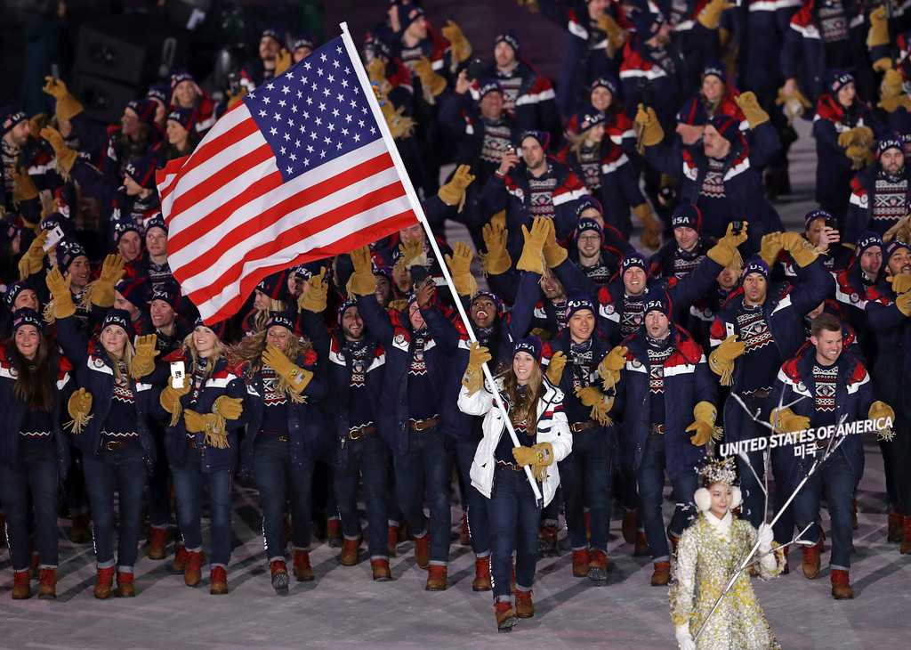 . Erin Hamlin carries the flag of the United States during the opening ceremony of the 2018 Winter Olympics in Pyeongchang, South Korea, Friday, Feb. 9, 2018. (AP Photo/Michael Sohn)