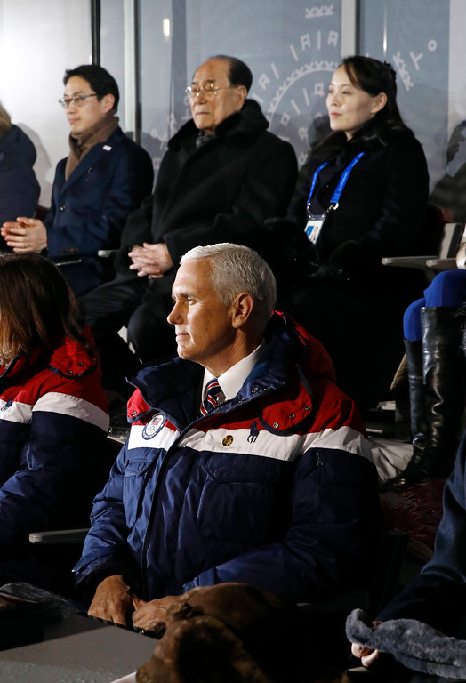 . Vice President Mike Pence, bottom, watches the opening ceremony of the 2018 Winter Olympics in Pyeongchang, South Korea, Friday, Feb. 9, 2018. Seated behind Pence are Kim Yo Jong, top right, sister of North Korean leader Kim Jong Un, and Kim Yong Nam, president of the Presidium of North Korean Parliament, second from right. (AP Photo/Patrick Semansky, Pool)