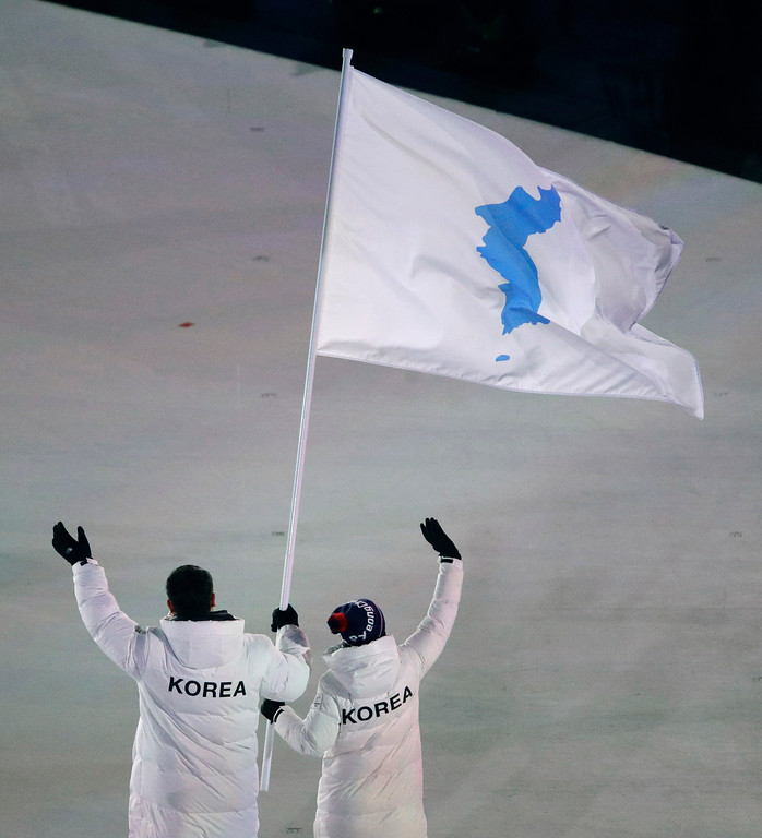 . North Korea\'s Hwang Chung Gum and South Korea\'s Won Yun-jong arrive during the opening ceremony of the 2018 Winter Olympics in Pyeongchang, South Korea, Friday, Feb. 9, 2018. (AP Photo/Charlie Riedel)