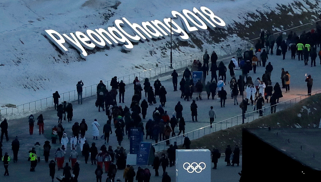 . People arrive at the Olympic Stadium ahead of the opening ceremony at the 2018 Winter Olympics in Pyeongchang, South Korea, Friday, Feb. 9, 2018. (AP Photo/Kirsty Wigglesworth)