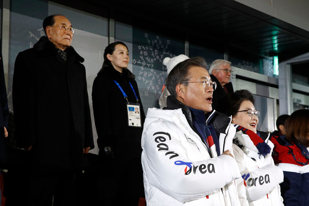 . South Korean President Moon Jae-in, second from bottom right, stands alongside first lady Kim Jung-sook as the South Korean national anthem is played at the opening ceremony of the 2018 Winter Olympics in Pyeongchang, South Korea, Friday, Feb. 9, 2018. Standing at top left is Kim Yong Nam, president of the Presidium of North Korean Parliament, and Kim Yo Jong, sister of North Korean leader Kim Jong Un. (AP Photo/Patrick Semansky, Pool)