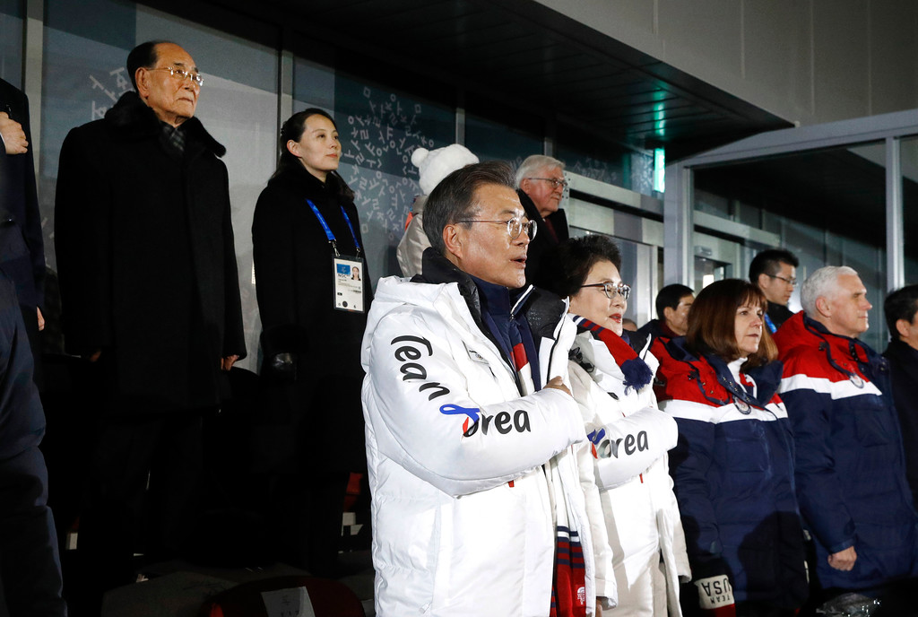 . South Korean President Moon Jae-in, center, stands alongside first lady Kim Jung-sook, U.S. second lady Karen Pence and U.S. Vice President Mike Pence as the South Korean national anthem is played at the opening ceremony of the 2018 Winter Olympics in Pyeongchang, South Korea, Friday, Feb. 9, 2018. Standing at top left is Kim Yong Nam, president of the Presidium of North Korean Parliament, and Kim Yo Jong, sister of North Korean leader Kim Jong Un. (AP Photo/Patrick Semansky, Pool)