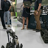 US Congresswoman Lori Trahan learns to drive SPUR (Squad Packable Utility Robot) from Corey Graham during her visit to the Waltham-based robot-developing company QinetiQ's ribbon cutting ceremony at their new facility on Devens Tuesday, August 27.2019. SENTINEL & ENTERPRISE/JOHN LOVE