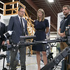 US Congresswoman Lori Trahan learns to about the SPUR (Squad Packable Utility Robot) from Corey Graham, right and Vice President of Land Systems Dan Deguire during her visit to the Waltham-based robot-developing company QinetiQ's ribbon cutting ceremony at their new facility on Devens Tuesday, August 27.2019. SENTINEL & ENTERPRISE/JOHN LOVE