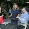 US Congresswoman Lori Trahan learns to operate a high mobility engineering excavator from Michael Kastanes during her visit to the Waltham-based robot-developing company QinetiQ's ribbon cutting ceremony at their new facility on Devens Tuesday, August 27.2019. SENTINEL & ENTERPRISE/JOHN LOVE