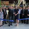 President of QinetiQ Jeff Yorsz an Congresswoman Lori Trahan cut the ribbon at the Waltham-based robot-developing company's ribbon cutting ceremony for their new facility on Devens Tuesday, August 27.2019. With them is employees, vendors and suppliers. SENTINEL & ENTERPRISE/JOHN LOVE