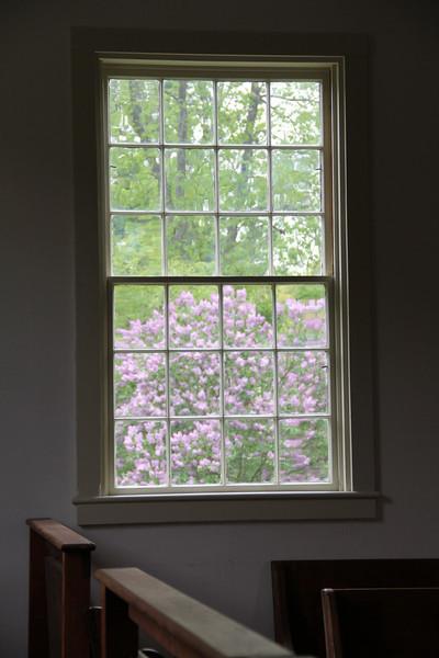 Spring, through a meetinghouse window.