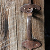 "Okay, I confess, I'm really taken with the assortment of latches and door handles that are tucked all over the hill This one is at the entrance to the barn beside the ""green house."""