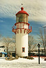 After 27 years of service the wooden tower began to show wear and a new cast iron tower was erected to replace it in 1907.  The prefabricated cylindrical tower was built by Barbier, Rénard & Turenne of Paris and was the second cast iron tower erected in Canada.  The new tower was also painted red and its lantern held a 1st Order Fresnel lens 190 feet above sea level.  The new light went into service on October 1, 1907.