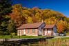 A home with fall foliage color near Saint Brigette de Laval, Quebec, Canada.