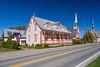 A street with homes and a church in the village of Saint Pierre on the island of Ile d'Orleans, Quebec, Canada.