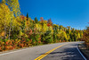 Fall foliage color in the trees with a park roadway in La Mauricie National Park, Quebec, Canada.