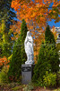 A madonna statue with fall foliage near the Saint Patrice church in Magog, Eastern Townships, Quebec, Canada.