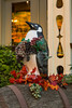 A penguin and grapes outside a wine shop in Magog, Eastern Townships, Quebec, Canada.