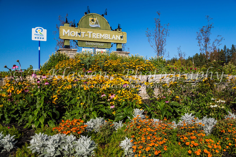 The Mont-Tremblant welcome sign with summer flowers, Quebec, Canada.