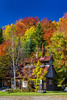 A sugar shack in a maple tree forest with fall foliage color near Brebeuf, Quebec, Canada.