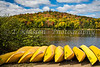 Yellow canoes and brilliant fall foliage color in the mountains of Mont-Tremblant National Park, Quebec, Canada.