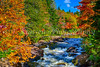 The Croches waterfalls and fall foliage color in Mont-Tremblant National Park, Quebec, Canada.