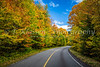 A park roadway and brilliant fall foliage color in the mountains of Mont-Tremblant National Park, Quebec, Canada.