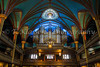 The Notre Dame Basilica interior architecture with pipe organ in Montreal, Quebec, Canada.