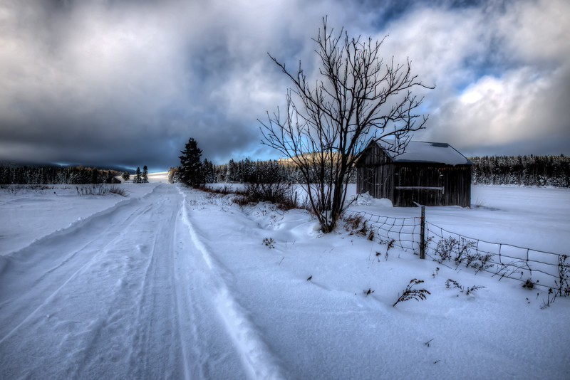 Barn along a snow covered road in Quebec Canada. It was about 15 degrees outside. Cold but very beautiful.