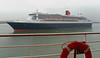Queen Mary 2, leaving Southampton, Mon 2 June 2008 3 - 1739.   Queen passes Queen.