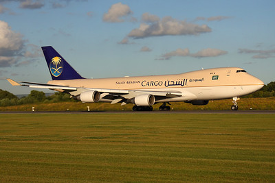TF-AMU - Saudi Arabian Airlines Cargo,. Boeing 747-48EF (c/n 27603 l/n 1210)  This Saudia freighter is operated by Air Atlanta on the Icelandic register, seen here in perfect evening sunshine departing Manchester's runway 23L. 30 July 2009