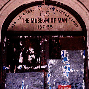 Detail: Flushing Town Hall as The Museum of Man (the words Man and Men appear in this image).