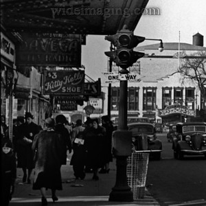 Incredible detail from:   http://www.wideimaging.com/Queens/Flushing-Archives/3273609_SVoat#751962046_Bqn38 Besides showing street clock at 2:55 this March 24, 1939 photo shows Davega City Radio, Kitty Kelly Shoes and the RKO Marquee.