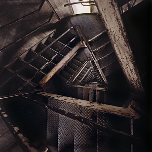 Stairs leading up the main tower. They say these stairs are now so degraded by corrosion that it is safer (and cheaper) to climb up the side with ropes to replace the airplane warning beacon. (I can believe that)
