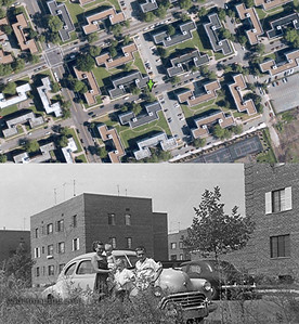 Summer of 1952 Kew Gardens 75th road near 153rd street. Siding now covers these cookie cutter buildings and the garage structures in the middle have been taken down, replaced with parking spaces.