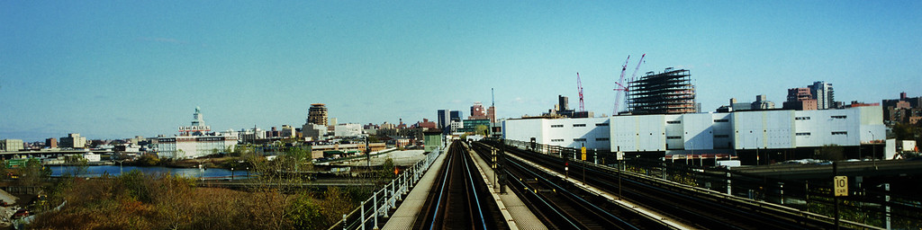 "View of the Flushing skyline from the No. 7 train. The former Serval Zipper factory clock tower, now a U-Haul storage facility, is in the center, Flushing's new skyline addition the gargantuan 14 acre billion dollar 1,100 unit condominium project ""Sky View Parc"" appears to the right.  From November 2008."