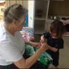Nan teaching Dakota how to sew