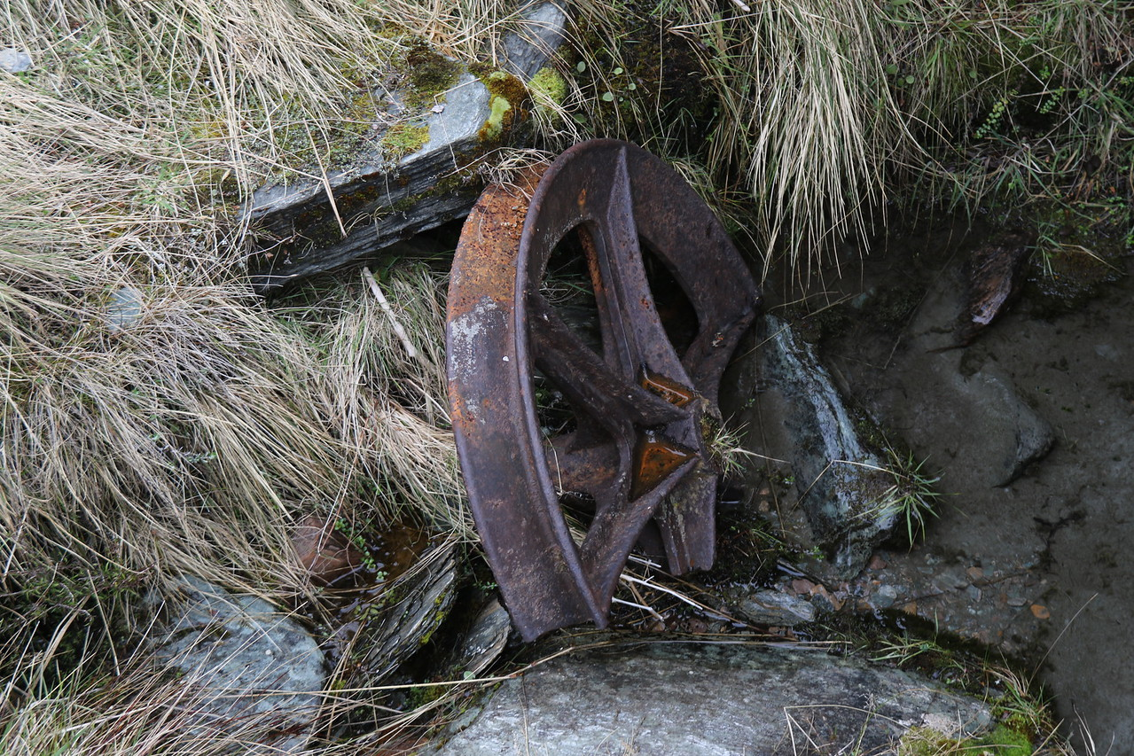 Aerial cableway pulley wheel - broken in creek