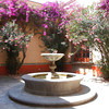 A Peaceful Patio With A Large Fountain