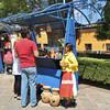 An Otomi Vendor With Clay Birdhouses