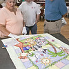 "The Fitchburg Senior Center is hold a three day quilt exhibition at their center that started Tuesday, August 20, 2019. Scott Arsenault and Edsel Johnson listen to patricia Legendre as she talks about this quilt in the show by Doris Vaillancourt, her mom, that was made in 1987 and called ""Jungle Happiness."" SENTINEL & ENTERPRISE/JOHN LOVE"