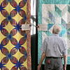 The Fitchburg Senior Center is hold a three day quilt exhibition at their center that started Tuesday, August 20, 2019. Robert Caron of Fitchburg looks over some of the quilts in the show. SENTINEL & ENTERPRISE/JOHN LOVE
