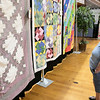 The Fitchburg Senior Center is hold a three day quilt exhibition at their center that started Tuesday, August 20, 2019. Nancy Little from Fitchburg looks over the quilts in the show. SENTINEL & ENTERPRISE/JOHN LOVE