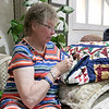 The Fitchburg Senior Center is hold a three day quilt exhibition at their center that started Tuesday, August 20, 2019. Sewing labels on to some of the quilts at the show is Judy Clonan from Fitchburg. SENTINEL & ENTERPRISE/JOHN LOVE