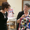 The Fitchburg Senior Center is hold a three day quilt exhibition at their center that started Tuesday, August 20, 2019. The curator of the show Lynn Thibault, right, talks to Susan Campbell about the quilts from the Fitchburg Historical Society that were in the show. SENTINEL & ENTERPRISE/JOHN LOVE