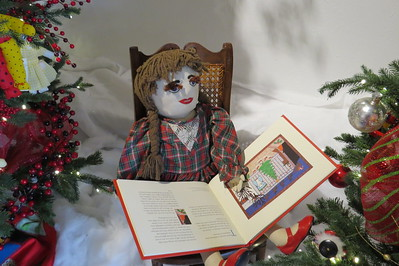 granny yount doll reading a book